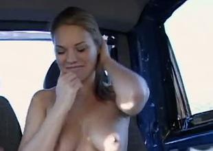 Amateur redhead playgirl Lucy strips in a car exposing fresh hawt body