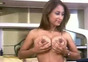 Sexy Indian actress with juicy jugs is posing of camera