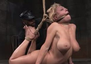 Busty blonde whore is tied up and stretched approximately S&m porn video