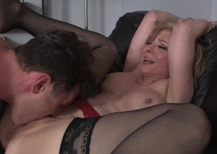 A blonde milf is getting fucked hard by her stepson on the bed