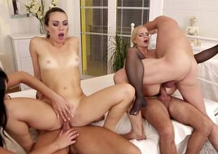 Two brunette chicks and a blonde are fucking in an orgy