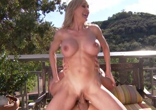 Fit milf sweetheart Brandi Love on top of his cock outdoors