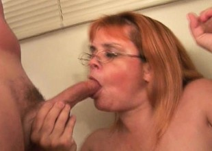 Plump grandma with glasses takes a pounding from a reinforcer of cocks