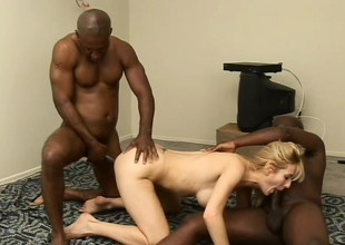 Unstinted breasted blond cougar has 2 black studs sharing her tight pussy