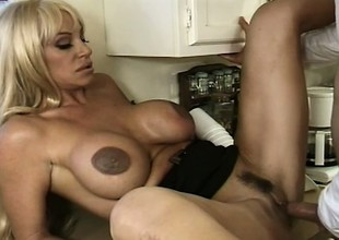 In the kitchen, buxom blonde mom Kat Kleevage sucks and copulates a juvenile stud's heavy rod
