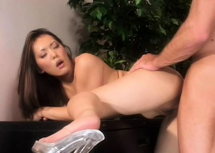 A accouterment of this Oriental office babe's venture is to drain her colleagues' balls!