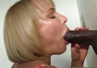 Glory hole blonde sucks black cock