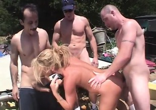 Wicked blonde milf Chelsea Zinn has three guys banging her holes outside