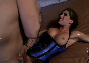 Nasty brunette quivers with pleasure as a long stick invades her a-hole