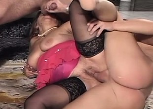 Marketable granny getting pounded by two juvenile studs in the conscious of room