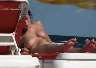 Sunbathing topless on a lucid day