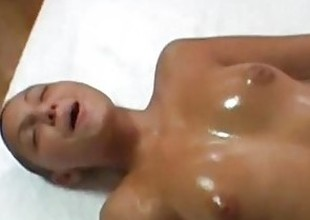 Hairless girl gets grease someone's palm massage together with facial