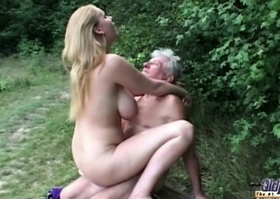 Natural huge titted slut fucks grandpa with regard to the woods