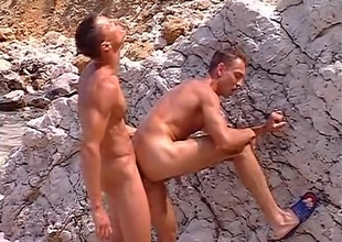 Delicious, near-hairless jocks Sylvio Panthera and Hans Brooks find a gravel pit, and use the venue to get some of their own rocks off, in this 9 minute quickie.  With big rocks on one side and go on a binge on the other, their juvenile muscles work up a sweat a