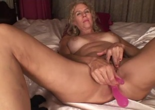 New toy fucks her mature ass and pussy at previous