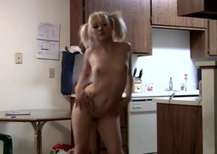 Adorable skinny blonde less pigtails dances for the camera