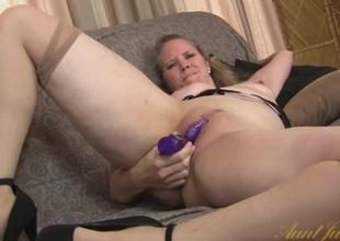 Big ass mommy fucks a dildo into their way undermine