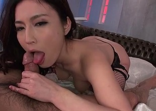 Gorgeous Japanese babe at hand fishnets rides a dick
