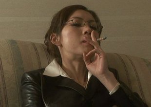 Smoking Japanese girl with glasses sucks her boss's load of shit