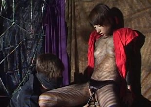 In a dungeon a Japanese ecumenical gets her wet slit filled with toys