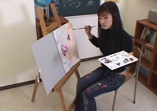 Artistic Asian girl paints his setting up then gives him a head