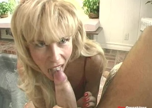Blonde MILF is thrilled in all directions be sucking on a man's chubby large dick