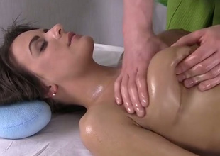 Unintentional masseur massages sexy boobies and thighs of gorgeous brunette