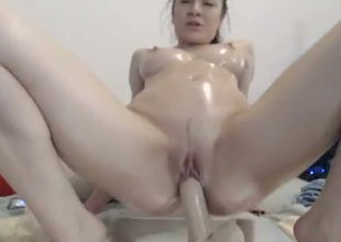 Huge tittied floozy rides her suction cup dildo like a prostitute possessed