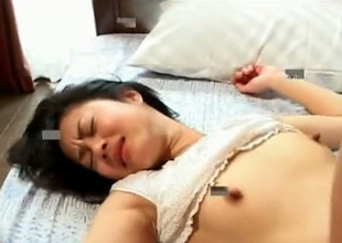 This Asian nympho has a lust for sex in front of the camera