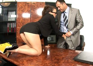 A very helpful secretary wears glasses space fully her boss nails her