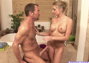 Large tit golden-haired masseuse telling a handjob to an mature dude