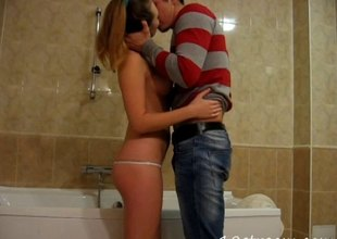 Charming teen in a thong sneaks her boyfriend to make an issue of go to the toilet for a hardcore pussy drilling session