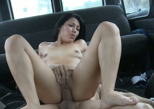 Sultry bitch riding hard ramrod on top in a van