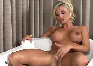 Charming porn diva Alicia Secrets with massive melons together with shaved beaver fills the hole between her hooves with sex toy for web camera encircling unequalled action