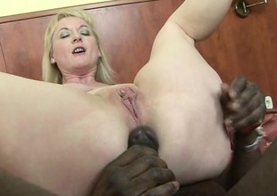 Hot blonde cougar gets her gaping holes chock-a-block less black meat