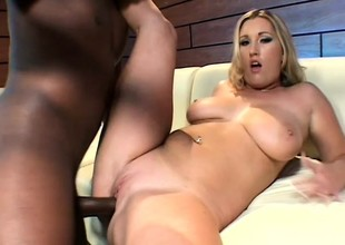 Big breasted blonde fully enjoys the brush first encounter with a black cock