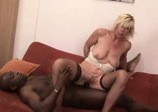 Sassy blonde MILF in stockings bends over for some chunky black penis