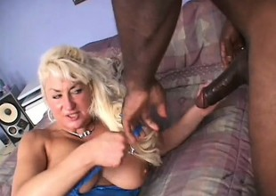 A large black boner gets buried in Dana's chubby granny snatch