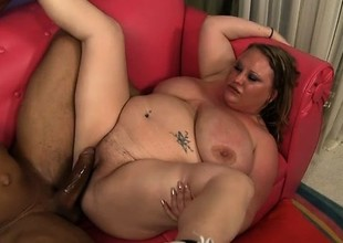 Chunky blond lady seizes the chance to have a huge gloomy cock drilling her peach
