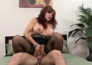 Mature redhead with a gigantic couple of knockers gets a shafting