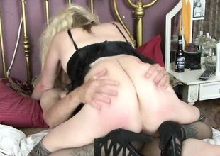 Blonde granny in black lingerie gets some coarse love from her man
