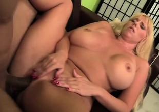 Blonde bimbo with massive fake tits gets team-fucked on the couch