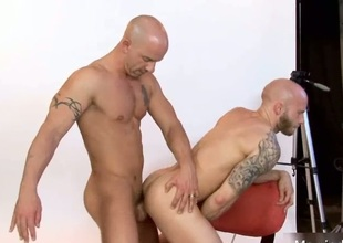 Astonishing bald stud fucked deep in ass