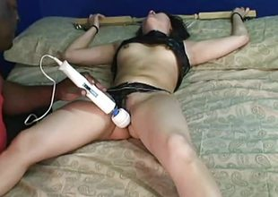 Dissimulate of a bdsm stuff hither some toy over her clit