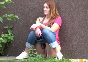 Redhead takes a piss on a catch sidewalk