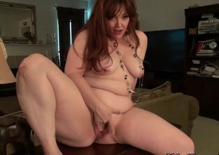American mommy Jewels gives their way pantyhosed pussy a treat