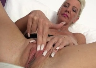 Granny with big fake tits fingers will not hear of pussy