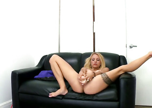 Teeny tits blonde is sucking a dildo